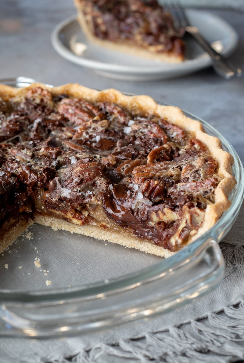 view of the inside of this gooey and chocolatey vegan pecan pie