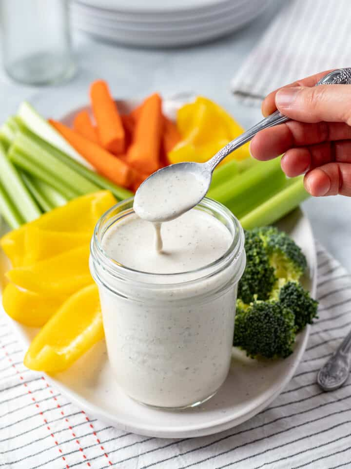 drizzling nut-free ranch from a spoon