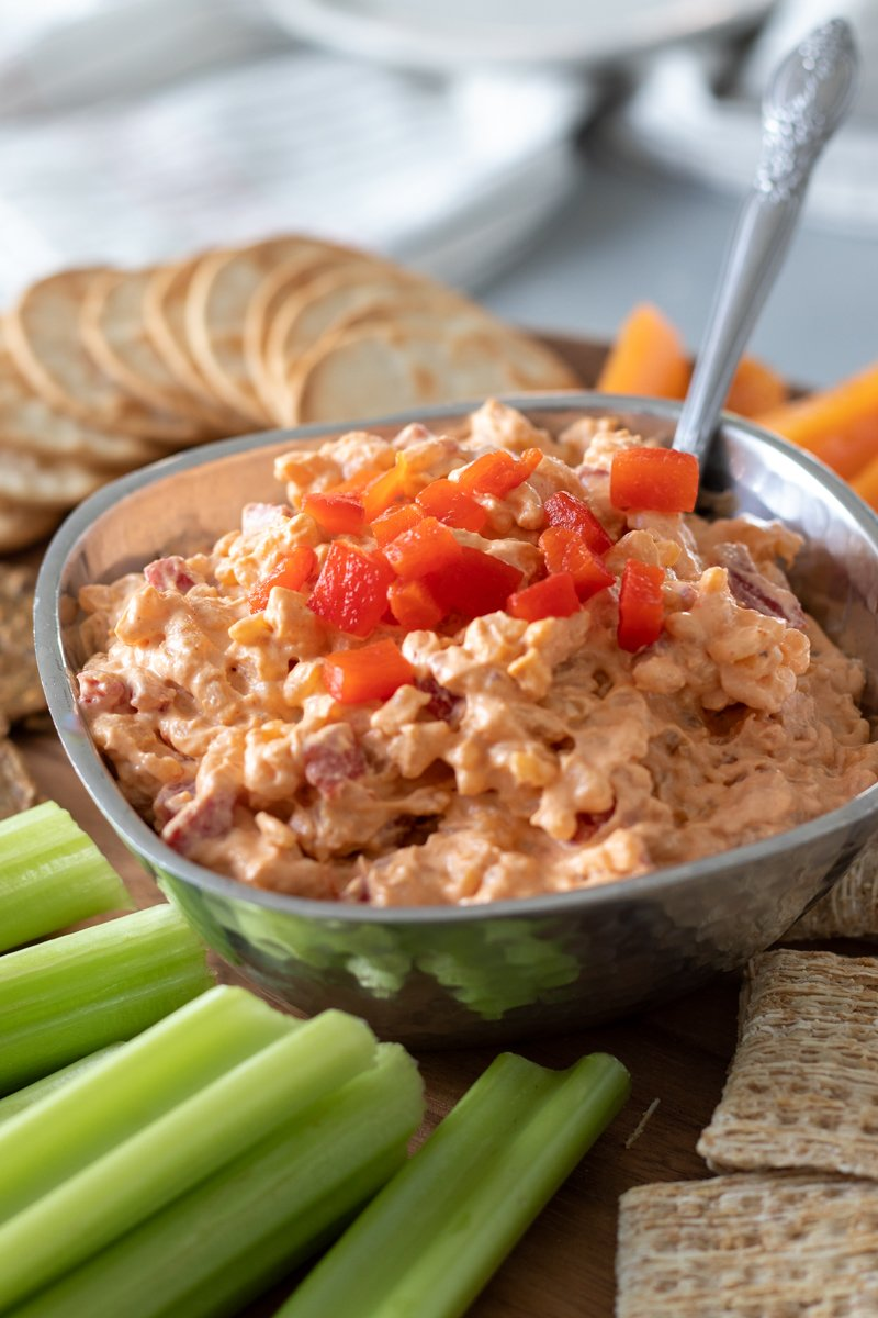 pimento cheese on a platter surrounded by celery and crackers