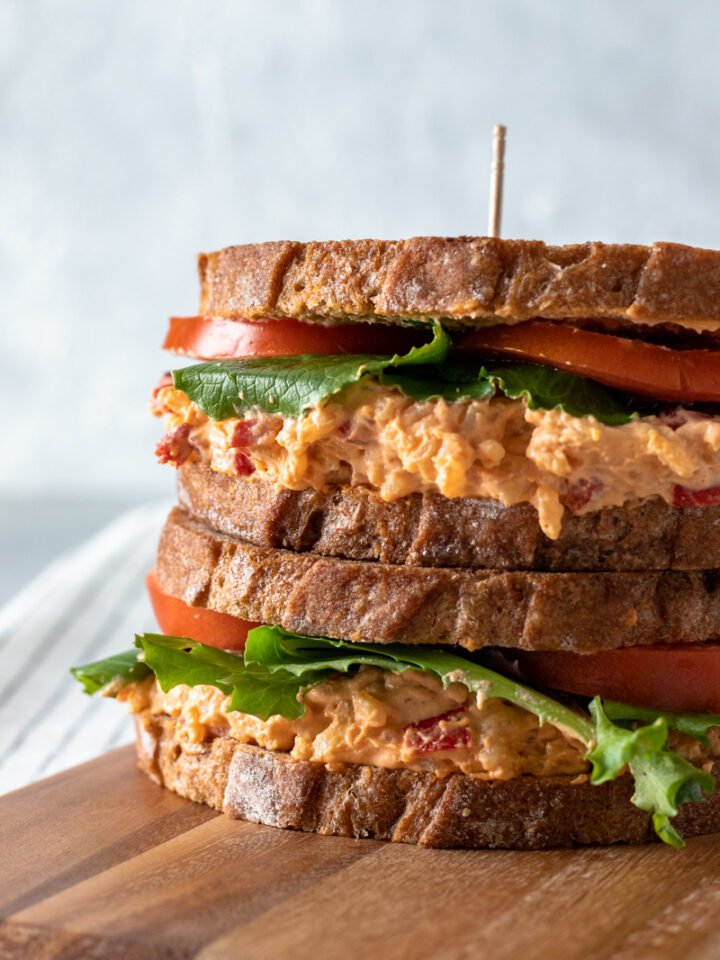 a stack of two vegan pimento cheese sandwiches