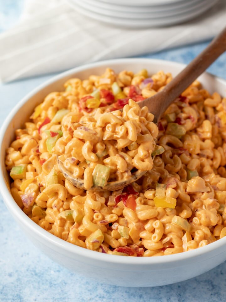 pimento macaroni salad in a large white serving bowl