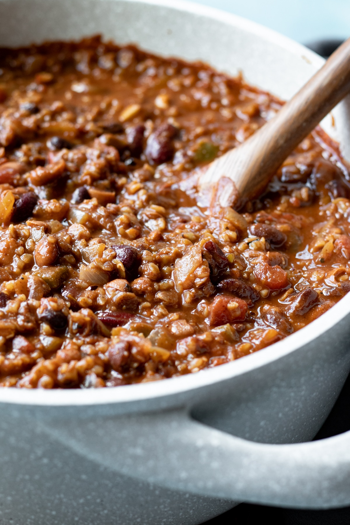 close up of red lentil chili with bulgur and 3 types of beans