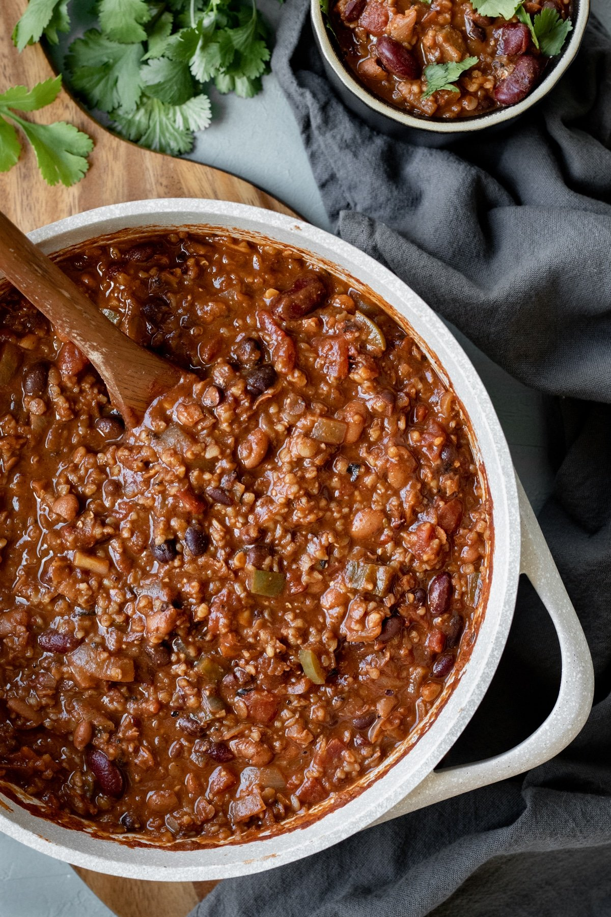 a big pot of vegan chili with a cup of chili on the side