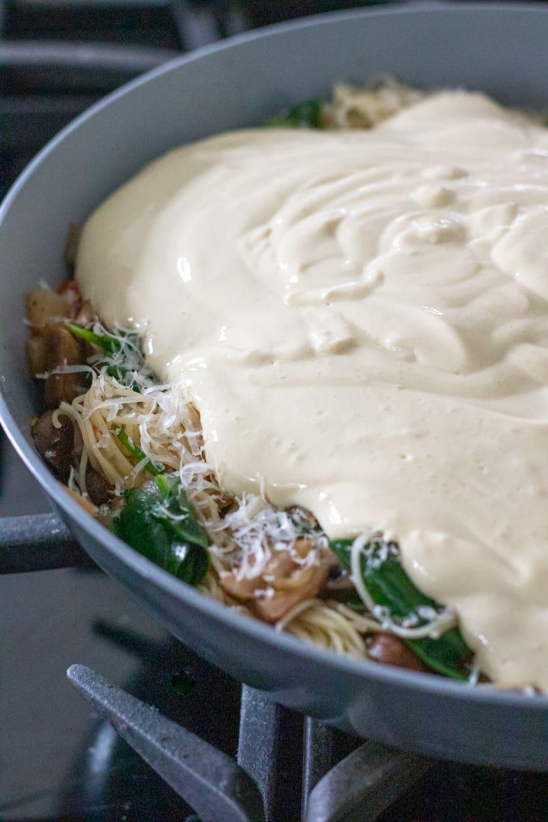 pouring tofu mixture into pan