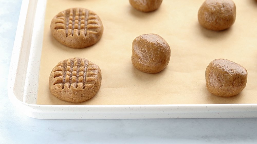 balls of peanut butter cookie dough on a baking sheet
