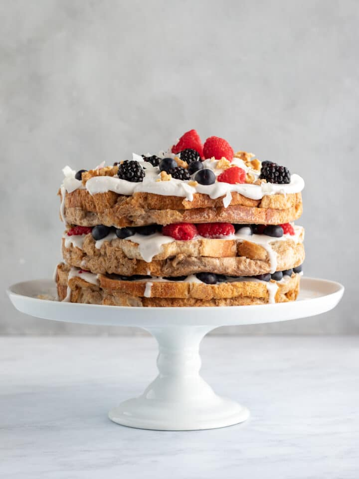 3-layer french toast cake on a white cake stand