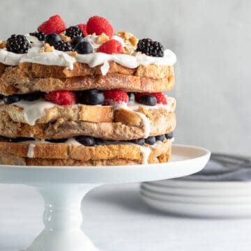 decorated french toast cake on a cake stand