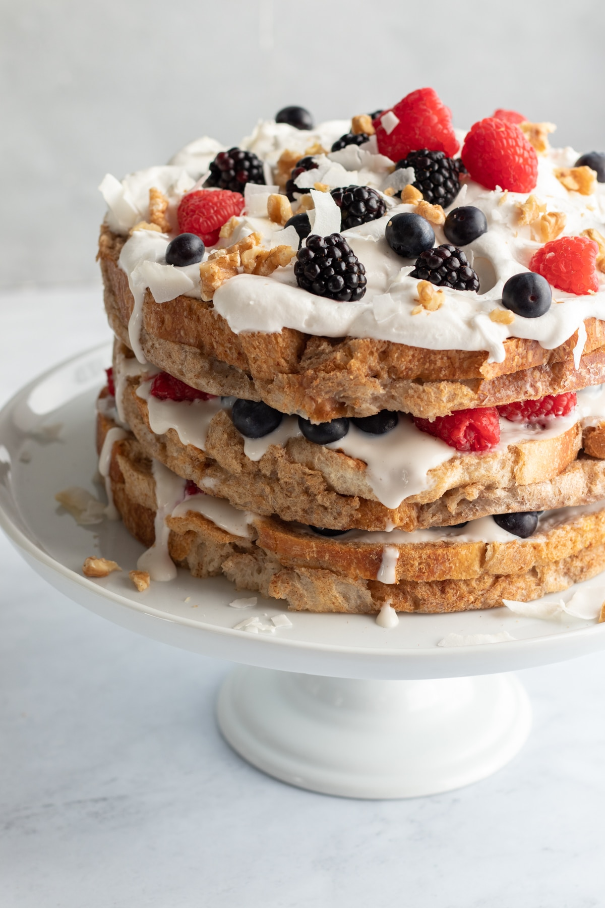 vegan french toast cake on a white cake stand