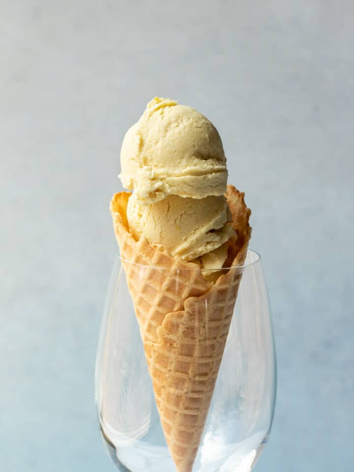 2 scoops of ice cream in a cone resting in a wine glass