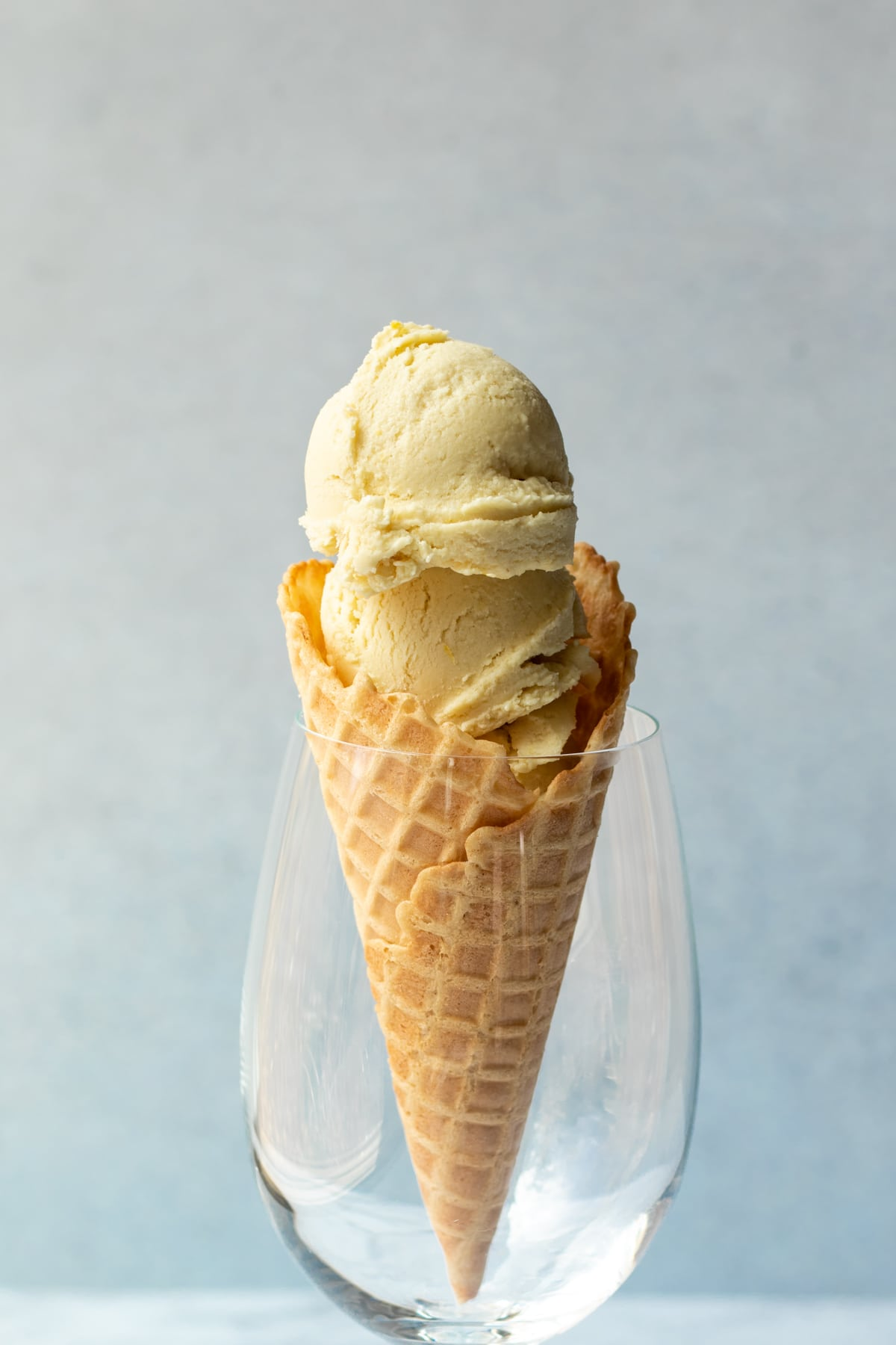 an ice cream cone held in a large wine glass