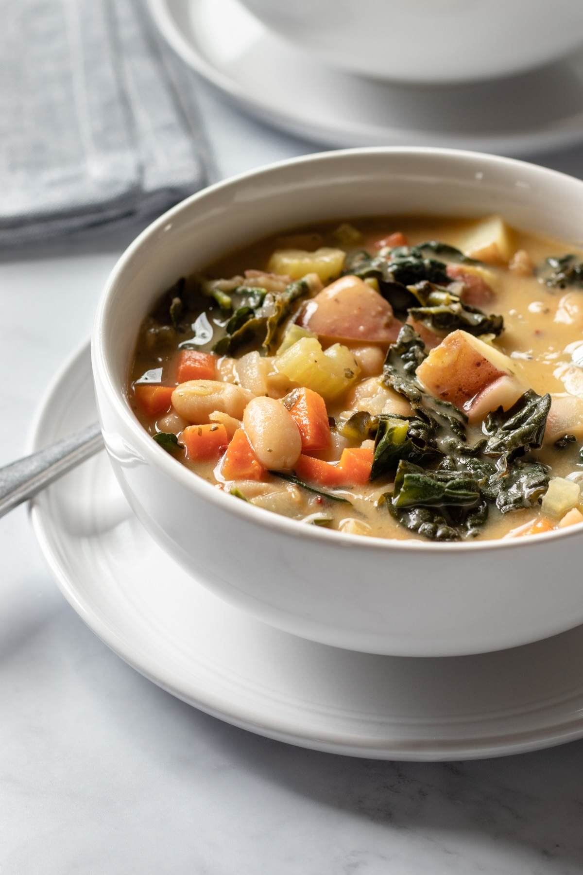 a bowl full of creamy Tuscan soup