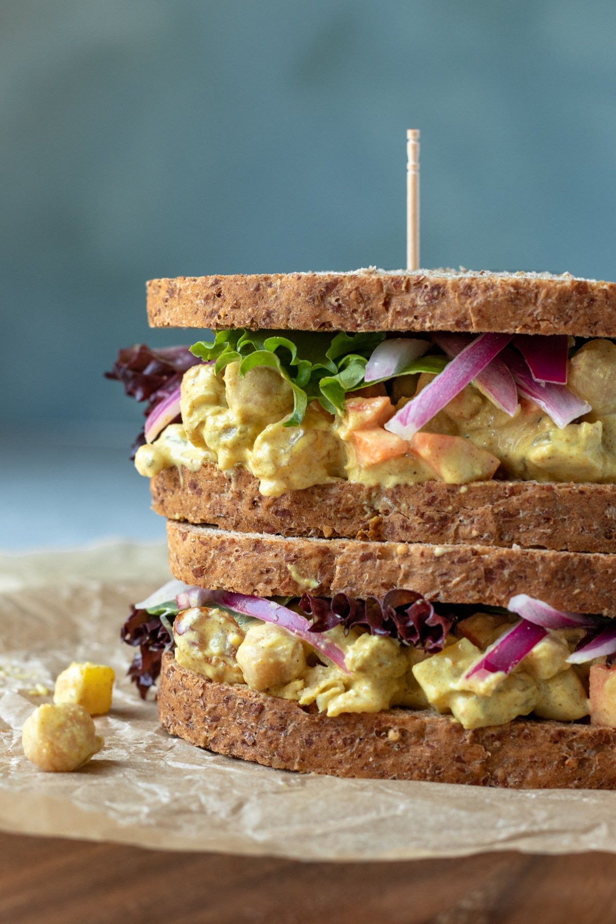 curried chickpea salad on whole-grain bread, two sandwiches stacked.