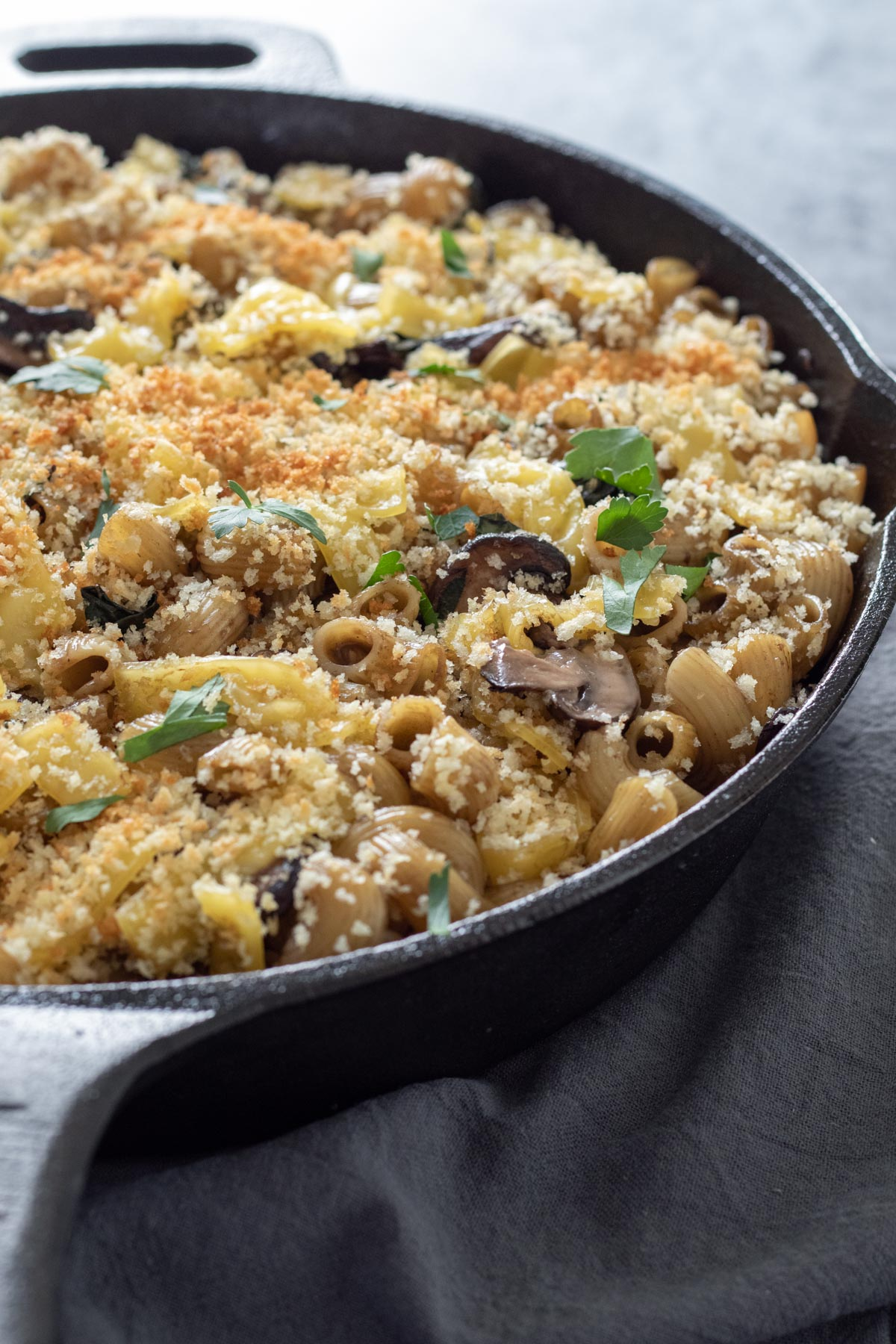 baked mushroom mac and cheese in a cast iron skillet