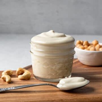 aquafaba mayo in a small jar on a wooden board
