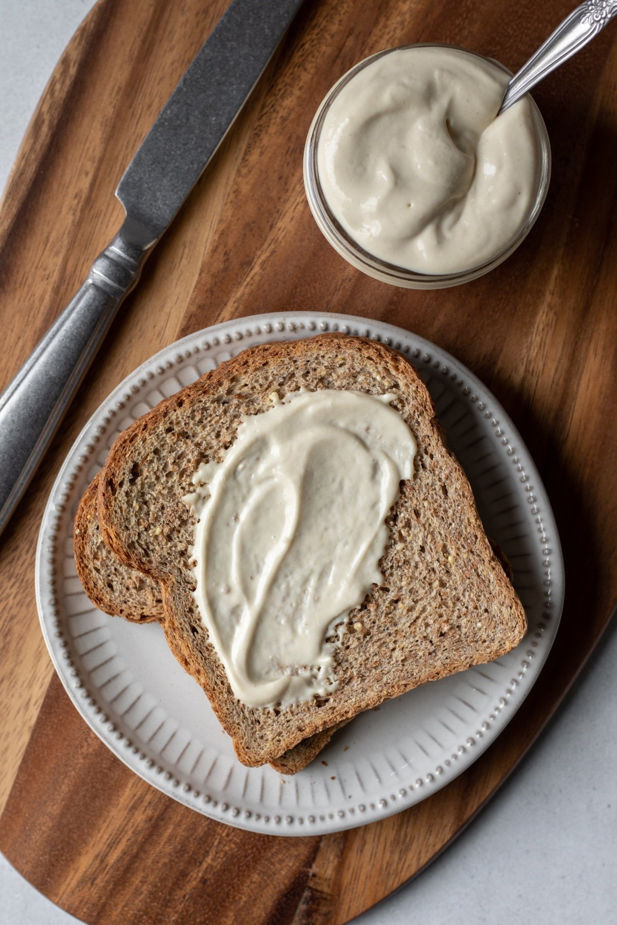 overhead shot of oil-free mayo spread on bread