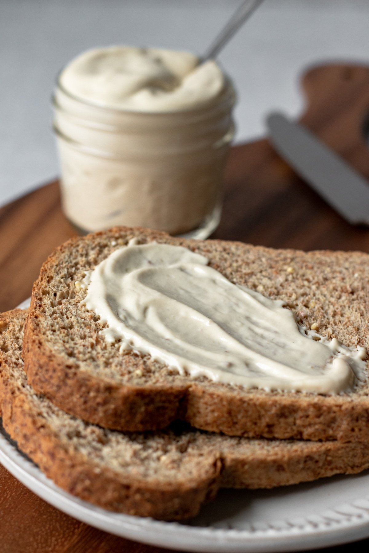 aquafaba mayo spread on a piece of toasted bread