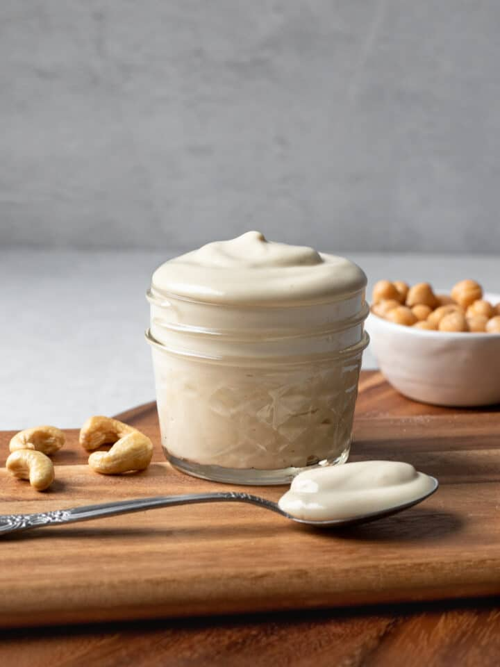 aquafaba mayo in a small jar on a wooden board