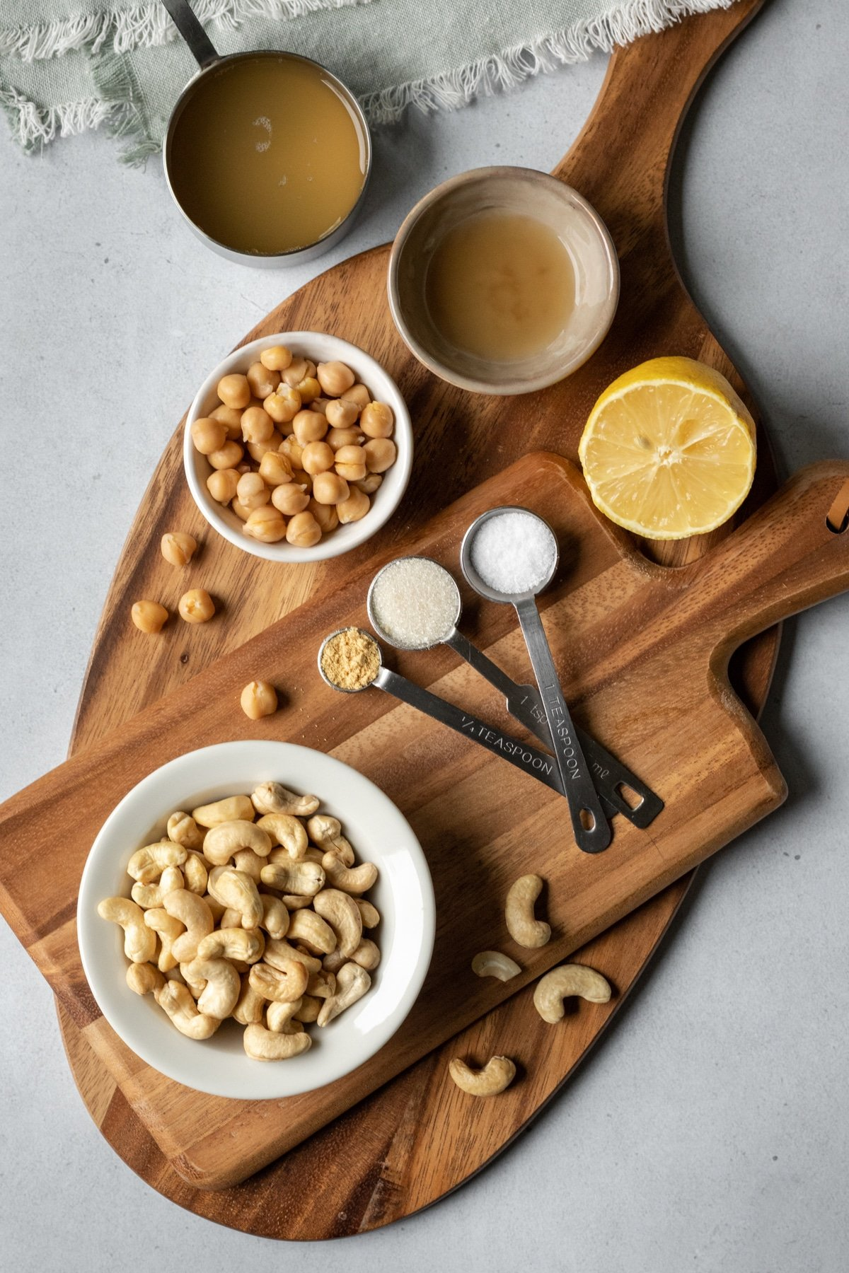 aquafaba mayo ingredients laid out on a cutting board.