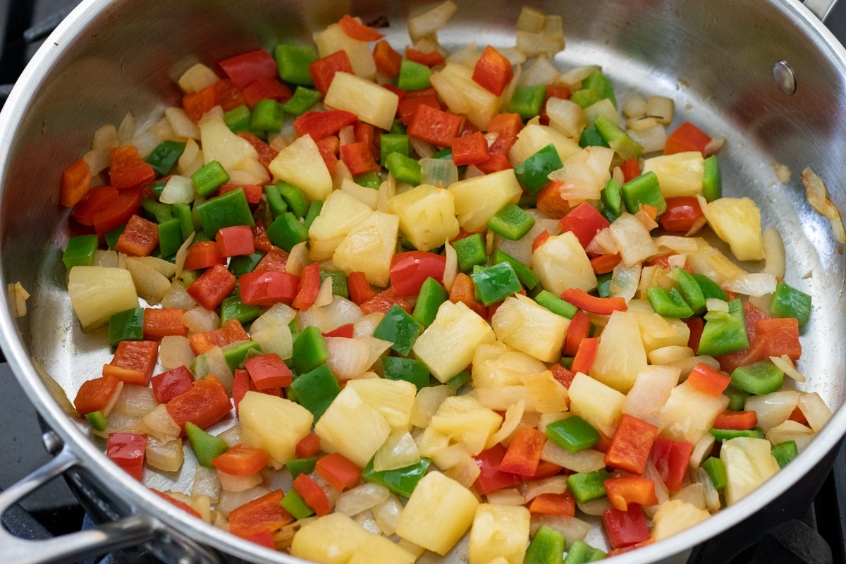 sautéing onion, peppers and pineapple