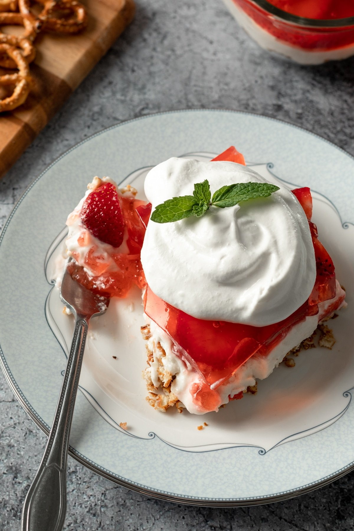 a serving of vegan strawberry pretzel salad on a plate
