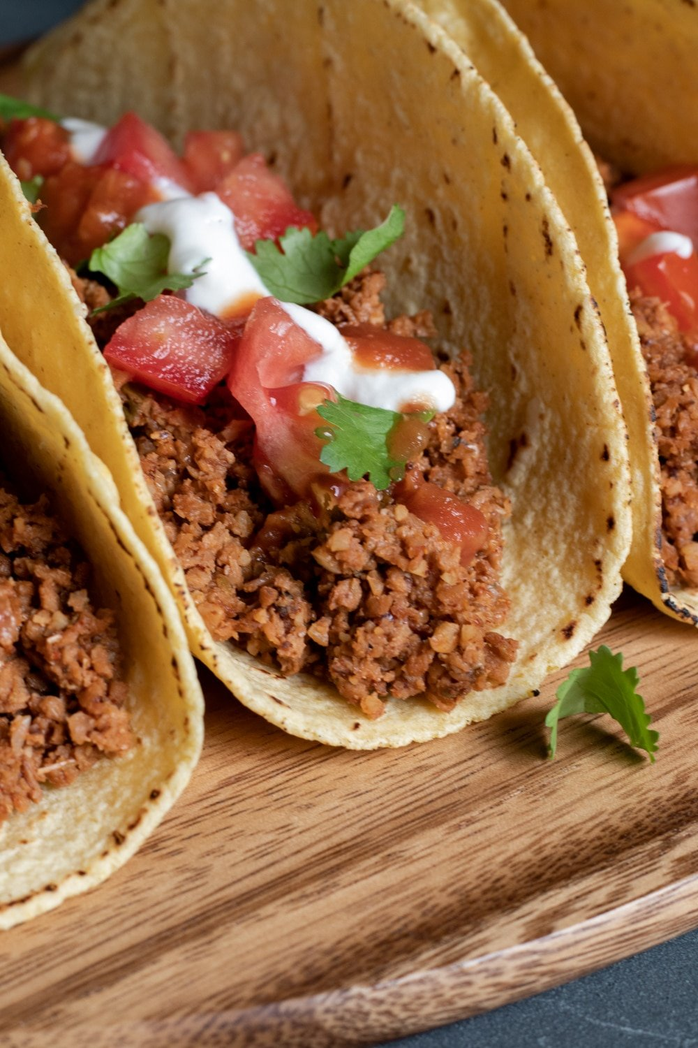 close up view of taco filled with crumbled soy curl meat