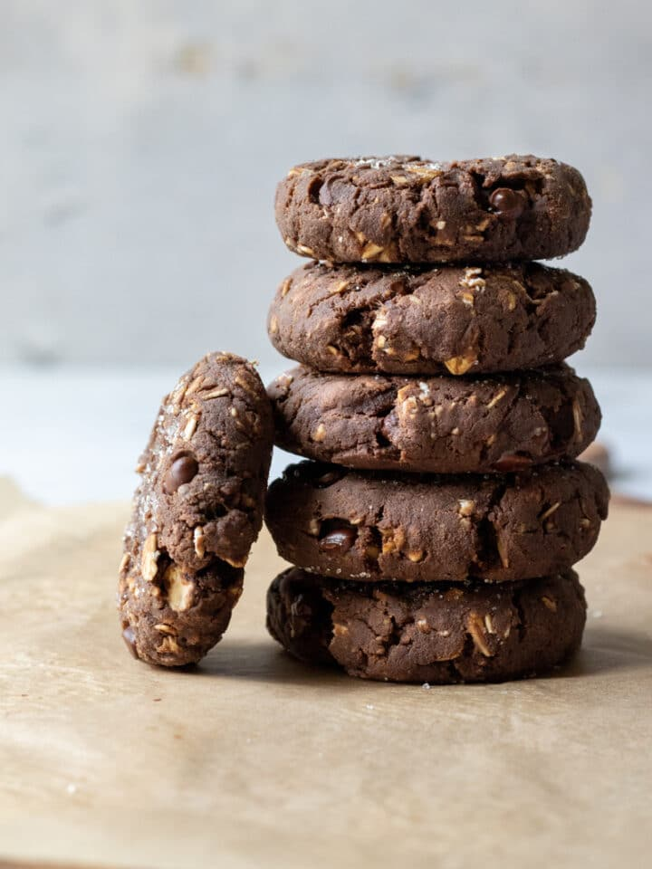 a stack of healthy protein cookies on parchment paper