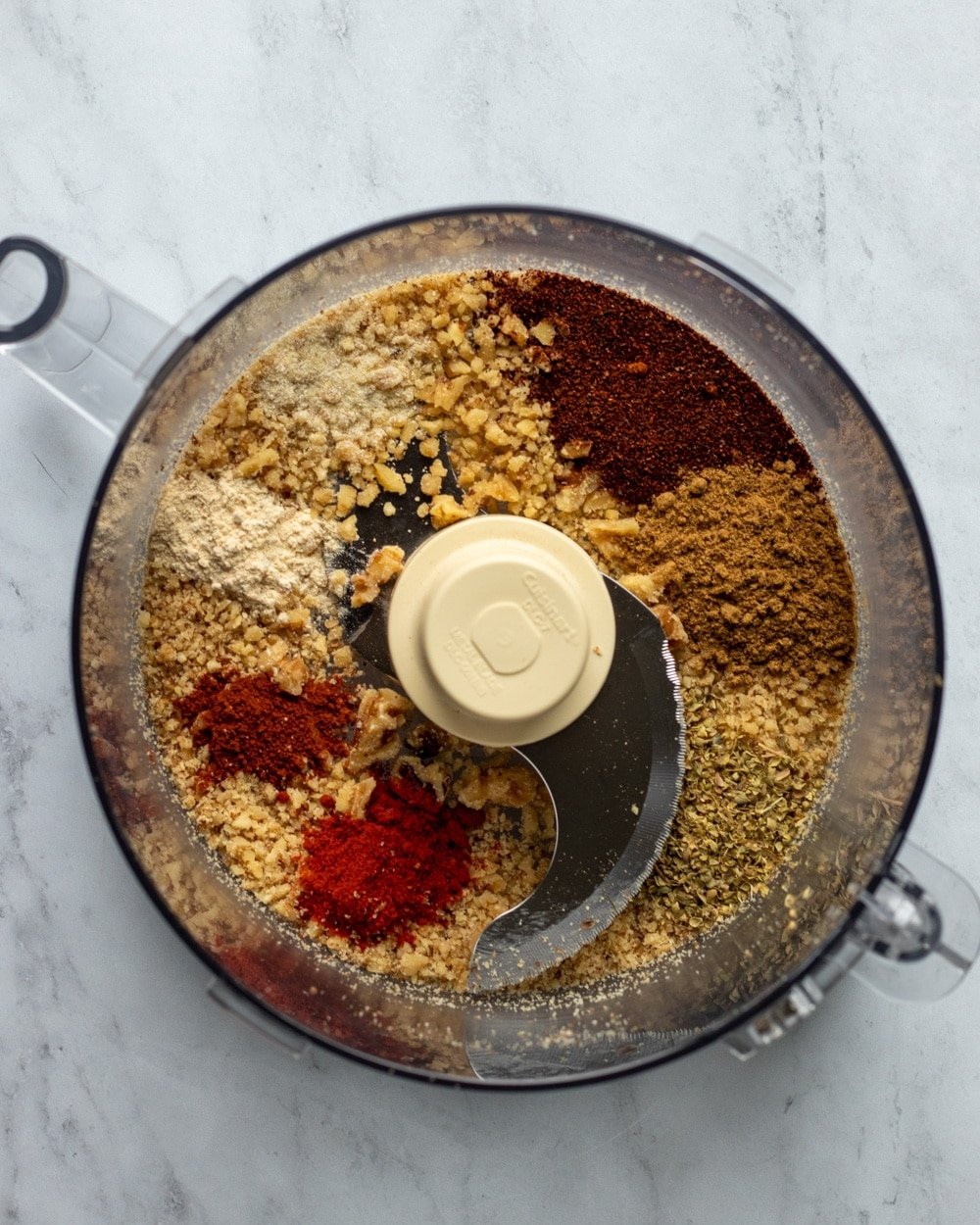 overhead shot of walnuts and spices in food processor