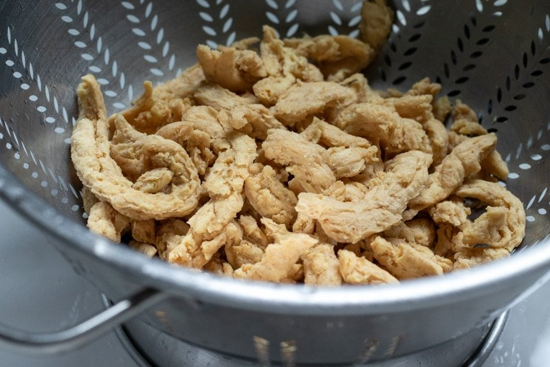 drained soy curls in a colander
