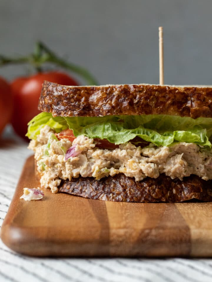 side view of vegan tuna salad sandwich, made with chickpeas and jackfruit, red onion, celery