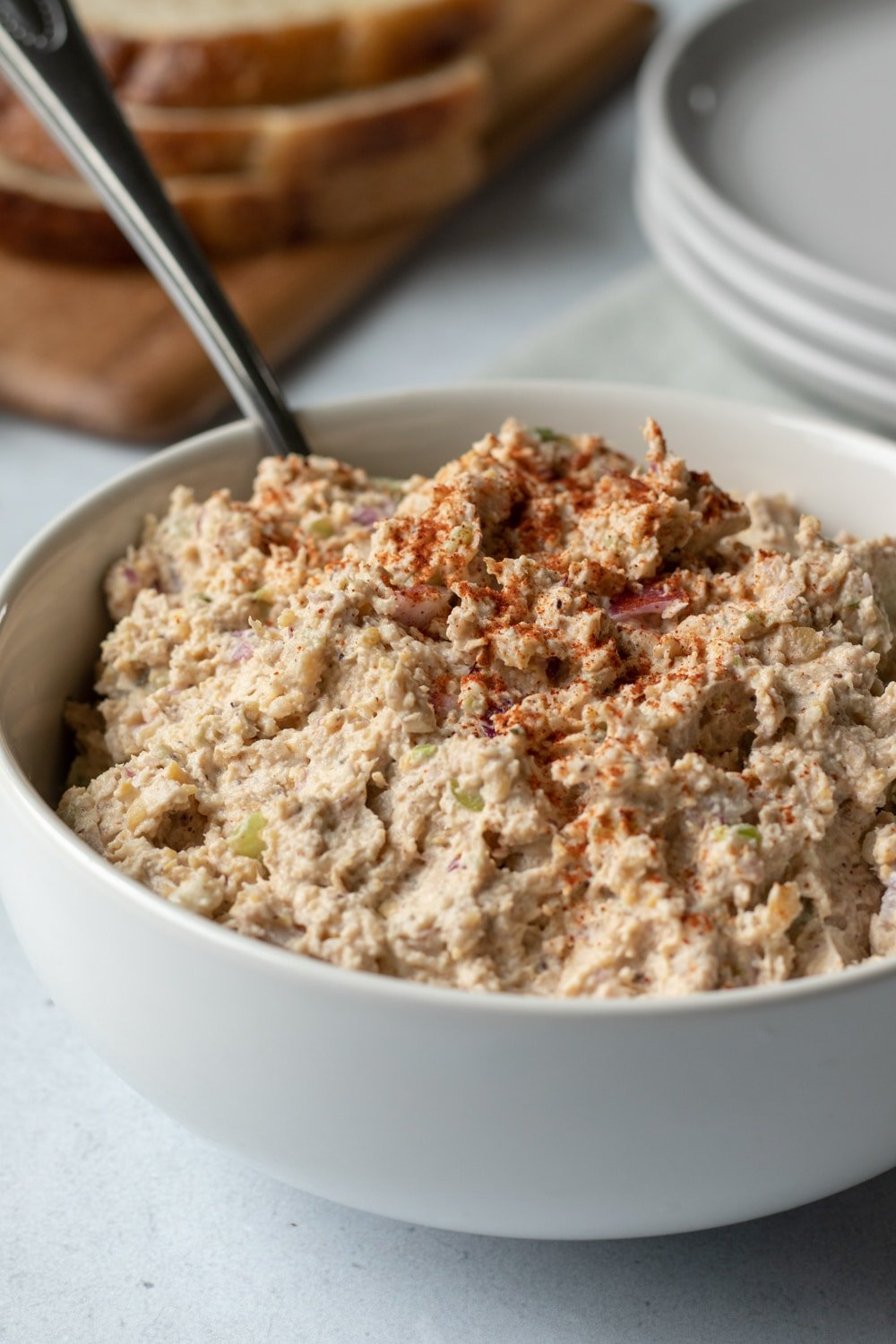 vegan tuna salad in a white bowl sprinkled with cayenne