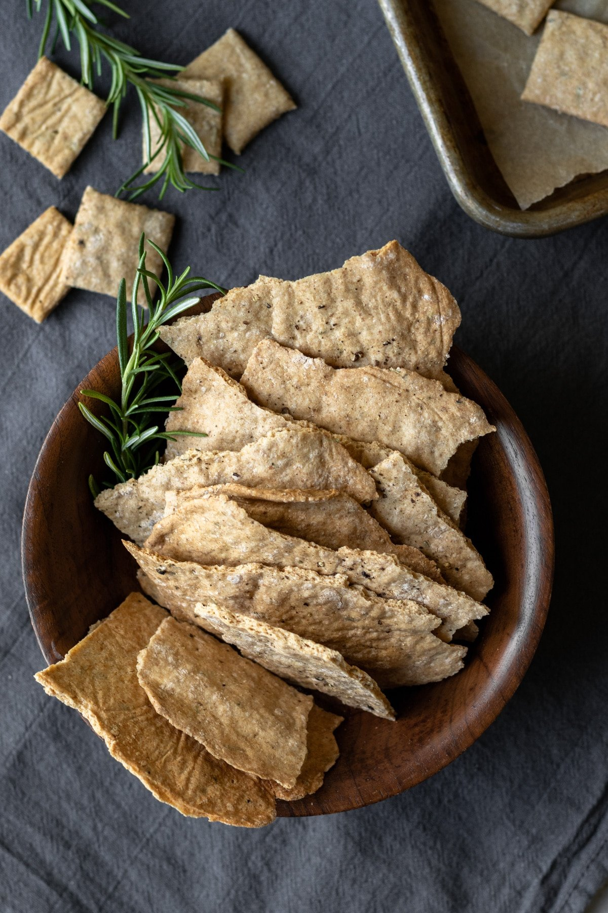 artisan whole wheat crackers on a wooden bowl