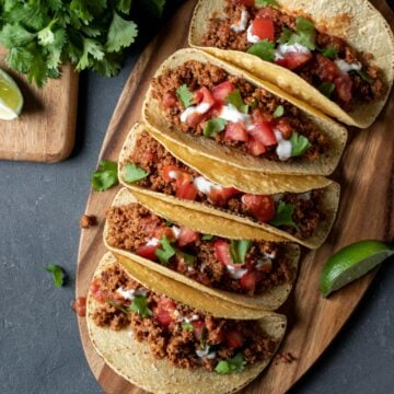 colorful soy tacos lined up on a cutting board.
