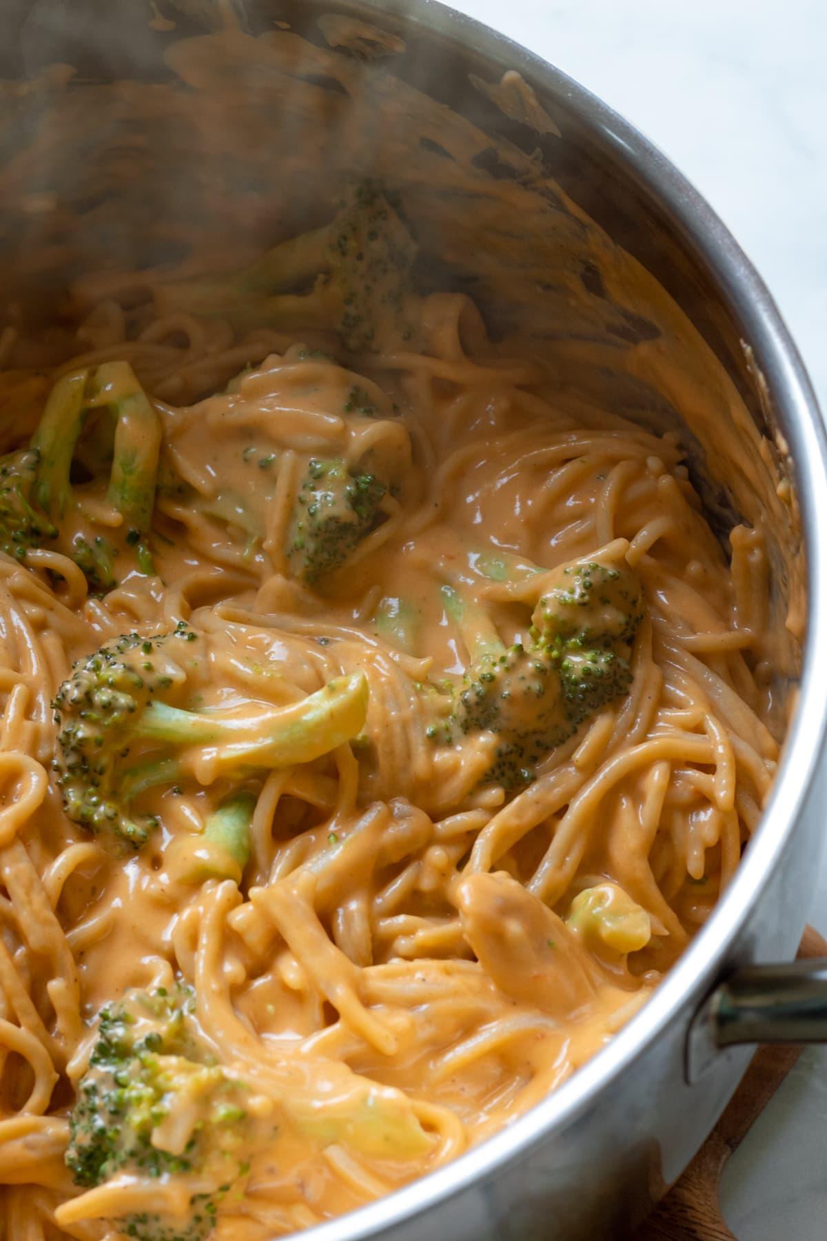 spaghetti and broccoli in vegan cheese sauce