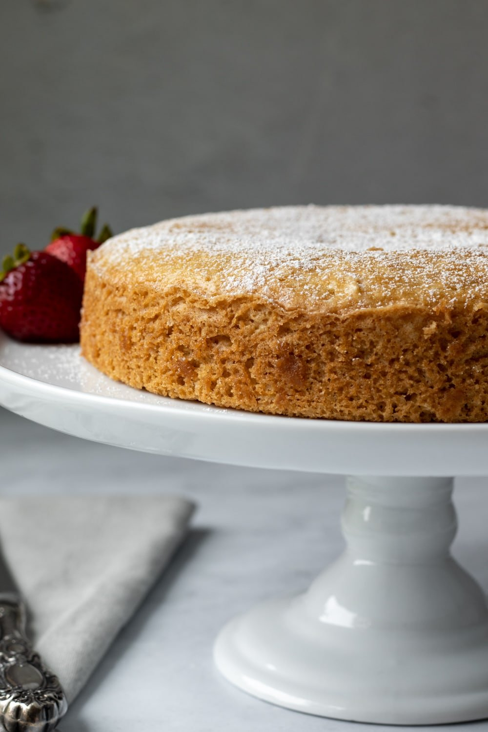 single layer yogurt cake on a cake stand