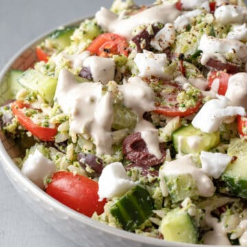close up of orzo salad drenched with creamy olive dressing.