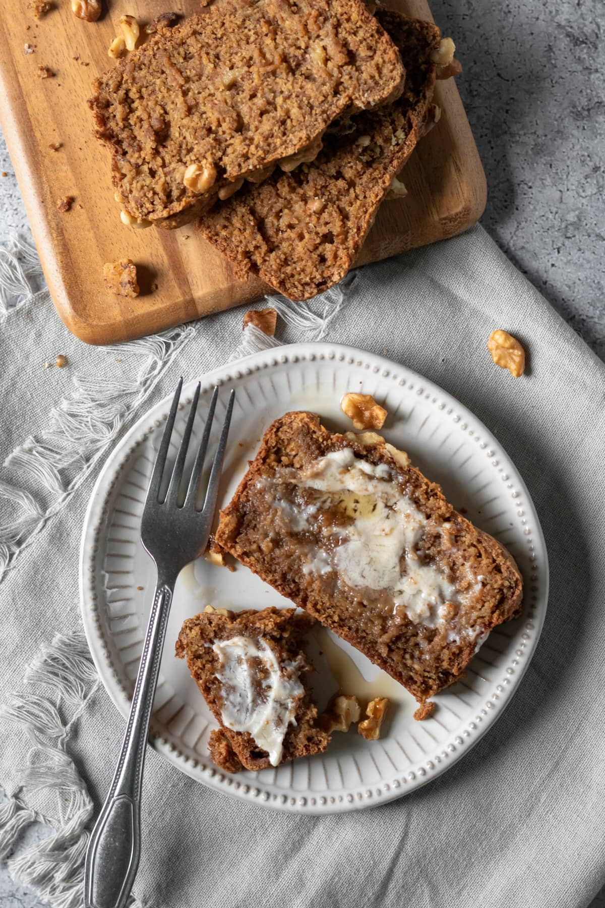 buttered banana bread on a plate