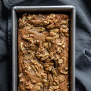 close up overhead of healthy banana bread in a loaf pan