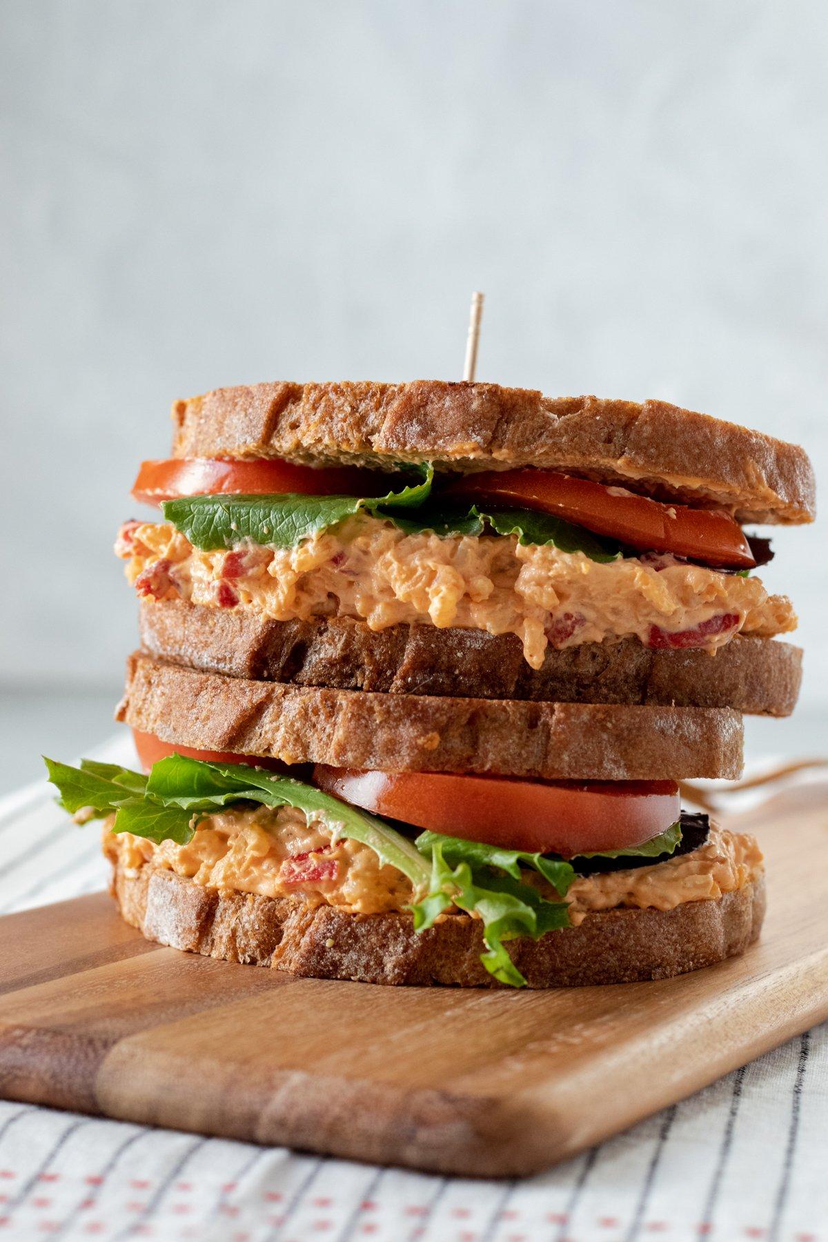 two vegan pimento cheese sandwiches stacked.