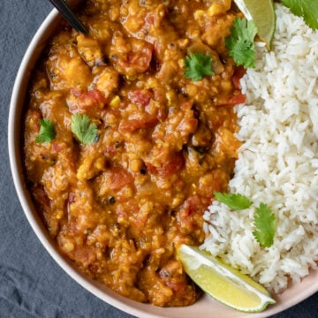 close up overhead of Instant Pot Lentil Curry and rice in a bowl