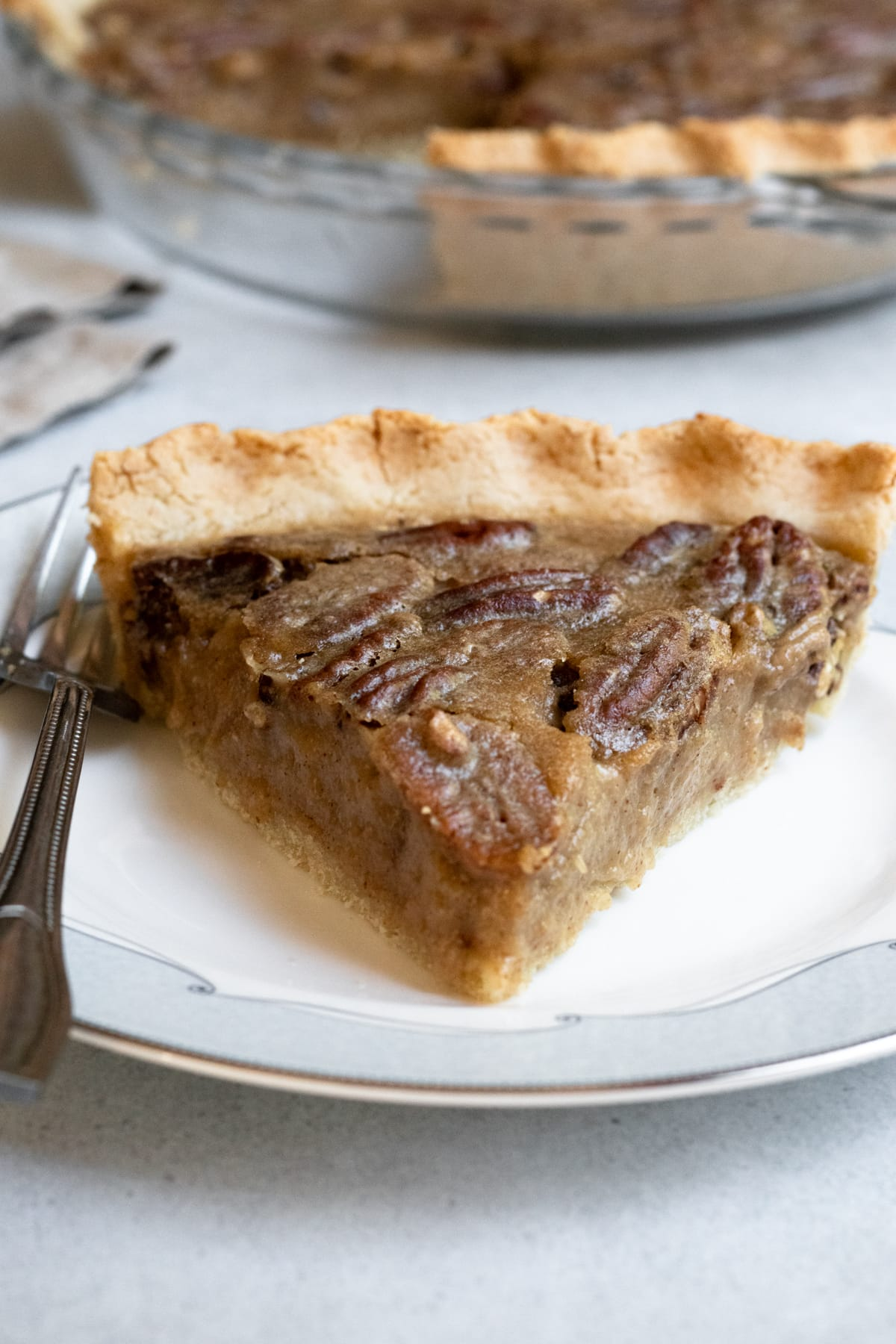 slice of maple pecan pie on a plate