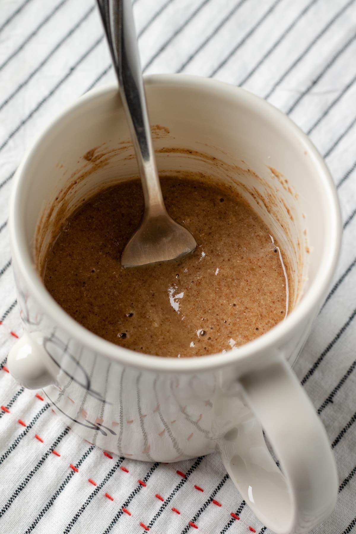 stirring together wet ingredients in a mug