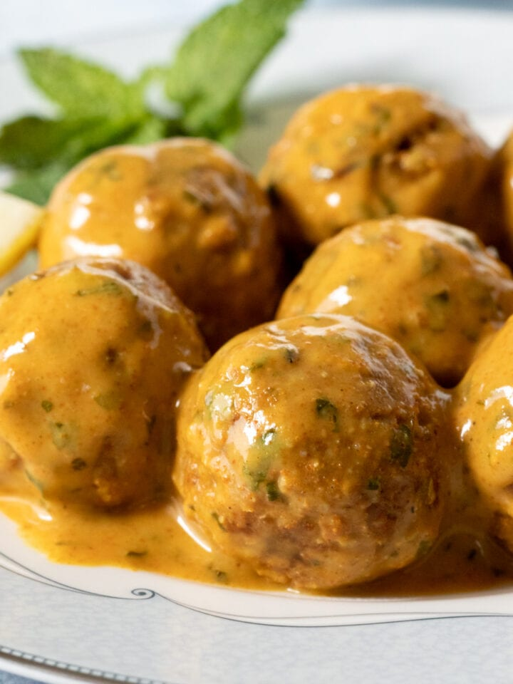 close up of saucy tempeh meatballs