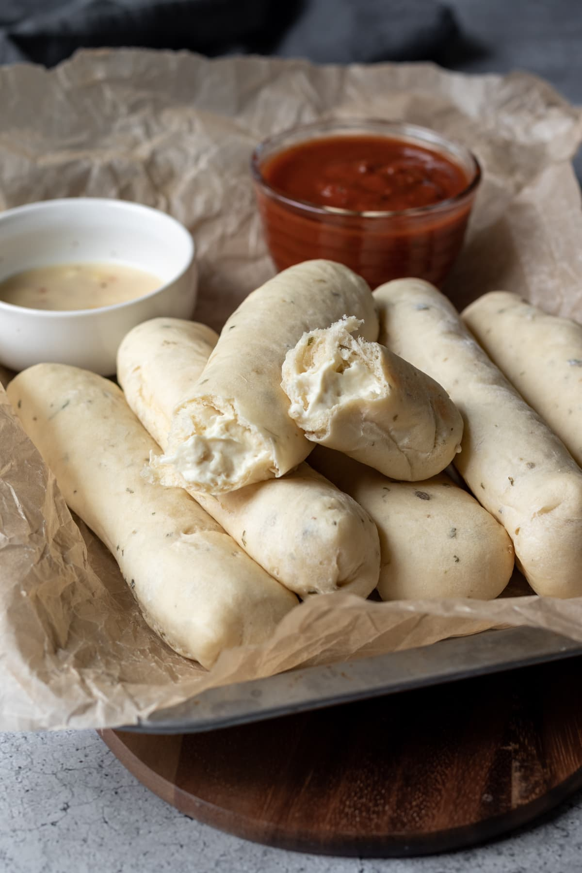 oil-free vegan cheese filled breadsticks with marinara and optional garlic butter
