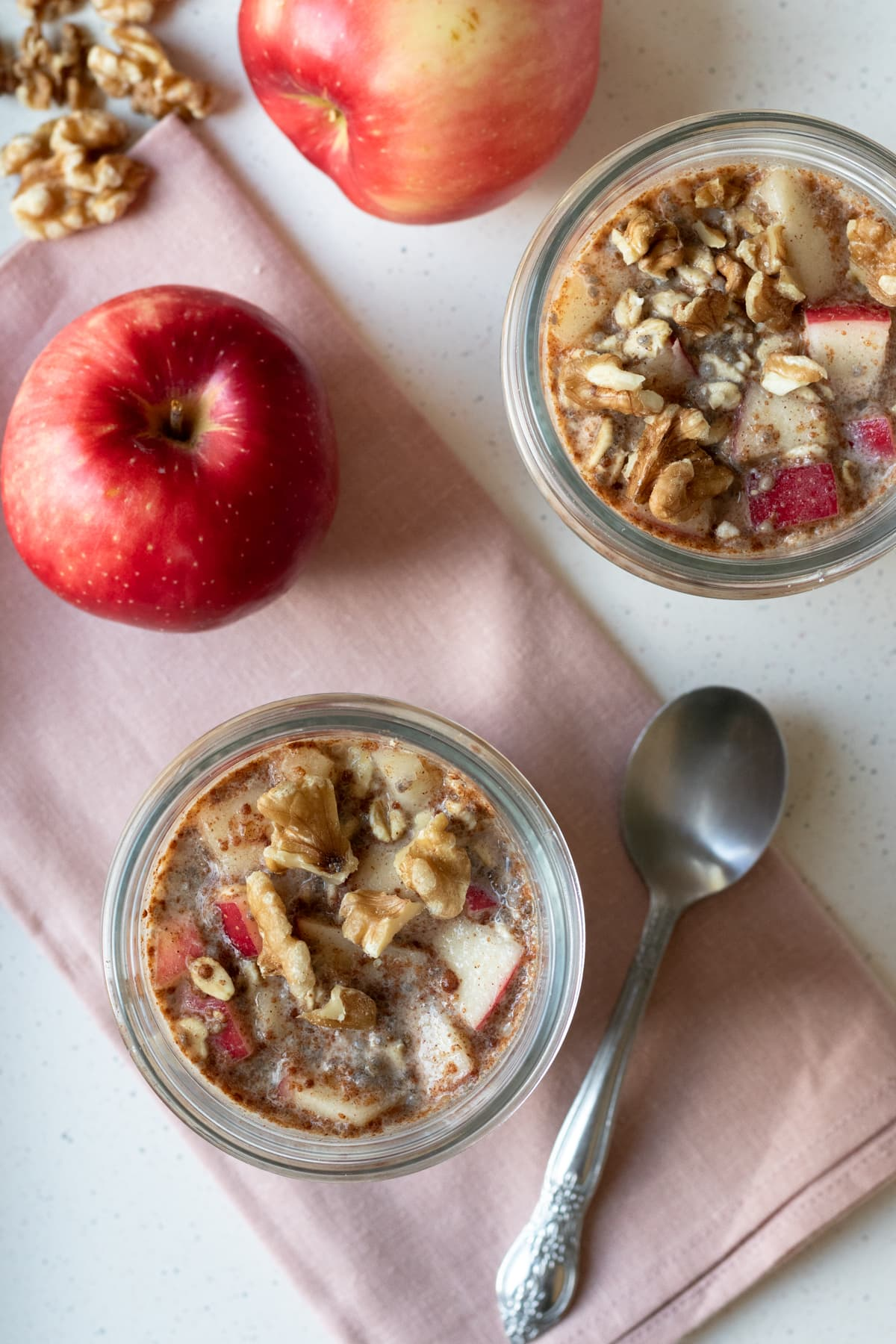 two jars filled with overnight oats that have already chilled.
