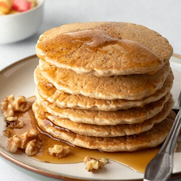 stack of vegan pancakes with maple syrup