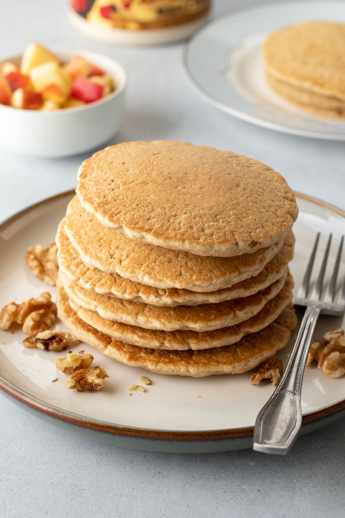 a stack of golden pancakes made with oat flour