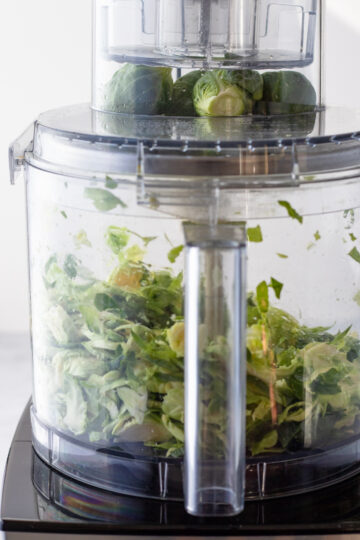 using the slicing disc in a food processor to shred brussels sprouts