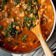 wooden spoon in soup in a pot