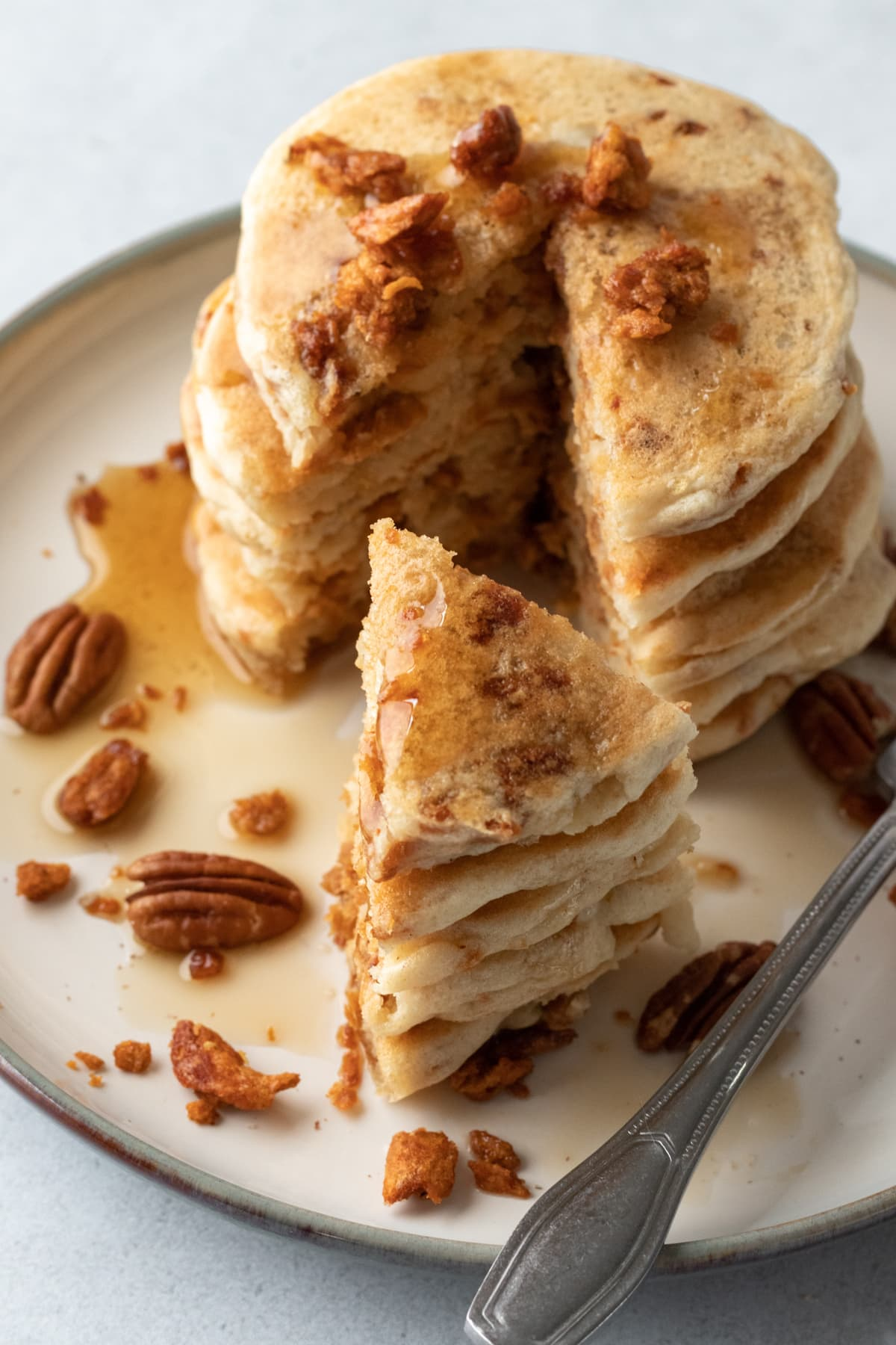 pancake stack drizzled with maple syrup