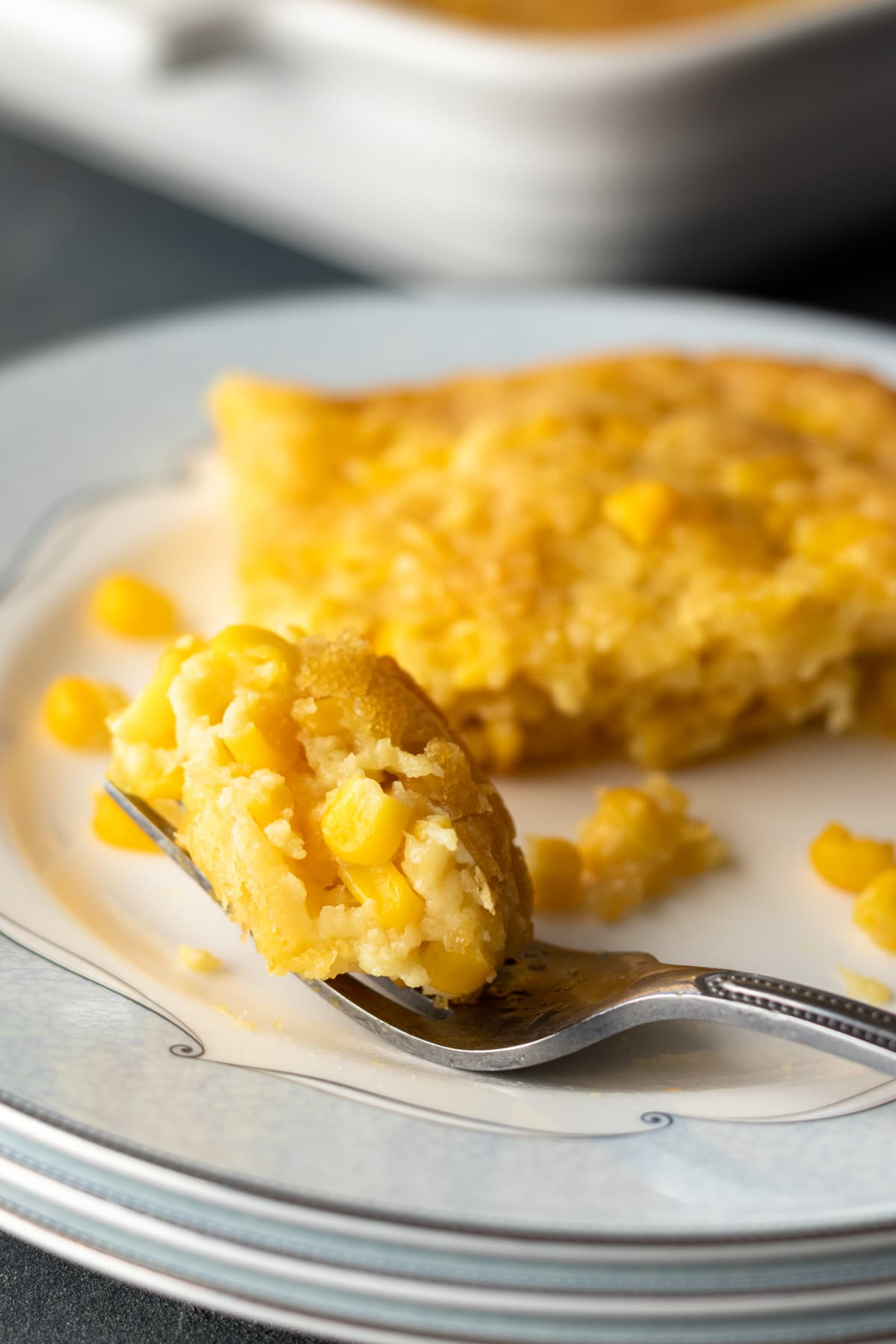 bite of corn pudding on a fork